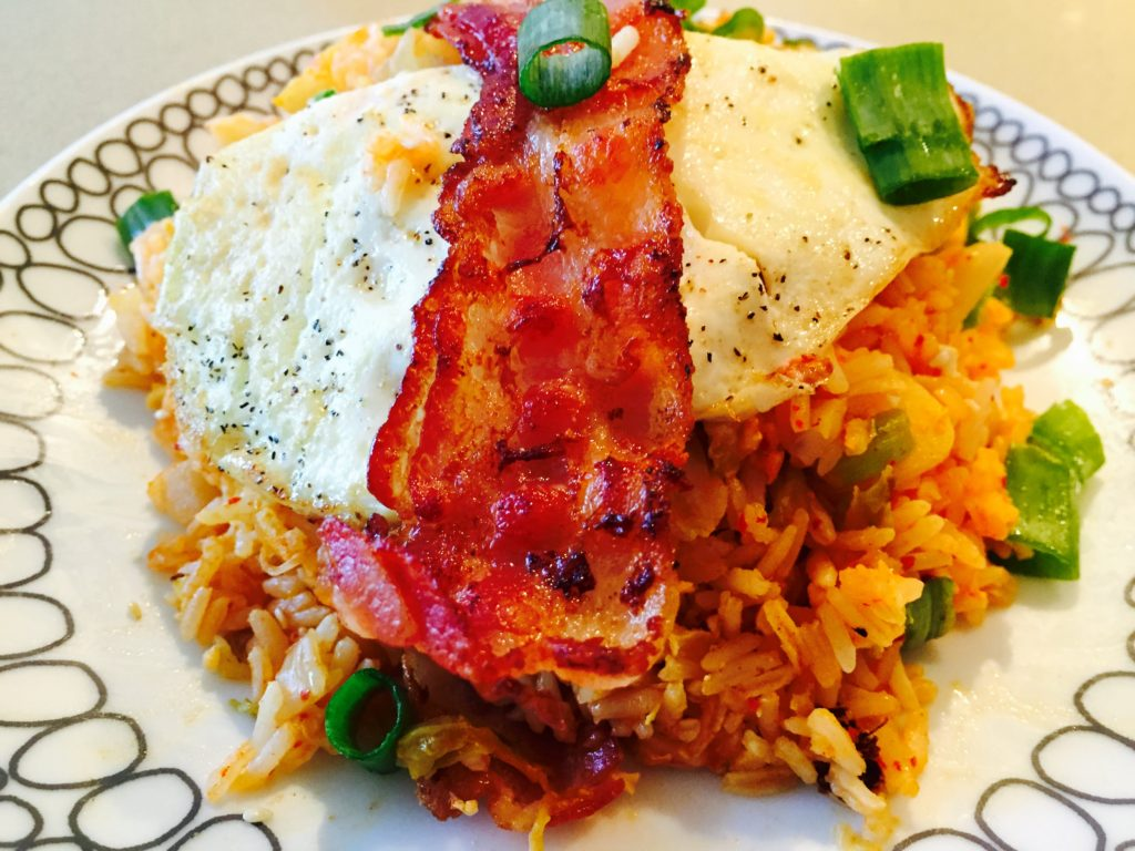 Kimchee and Bacon Fried Rice Recipe that is easy comfort food. This is faster then take out and perfect weeknight dinner. www.ChopHappy.com