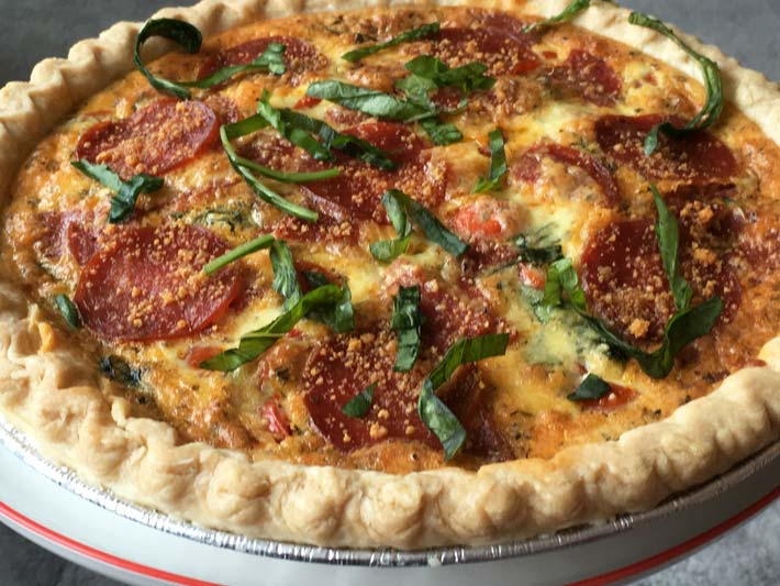 NYC Pepperoni Pizza Quiche Recipe that is make ahead easy. Grab some eggs, cream, and Italian seasonings and you have the perfect brunch recipe. www.ChopHappy.com
