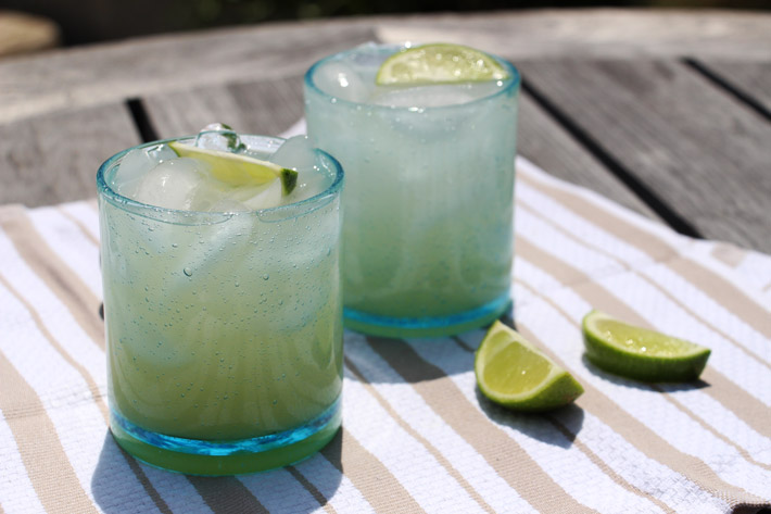 Sunshine Tequila Colada Recipe. Crazy easy with only a few ingredients. Grab tequila, coconut water, pineapple juice, and limes. This is a cocktail for a crowd. Happy drinking making. #tequila #easycocktailrecipe