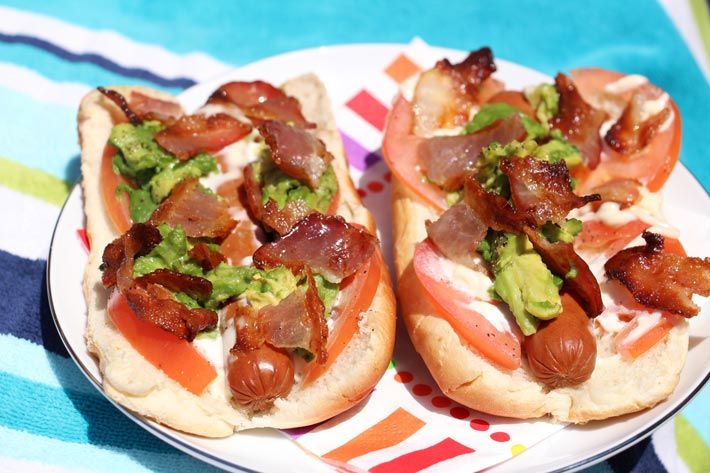 Bacon Avocado Dog Recipe - is so easy you get instant comfort food satisfaction. Grab hot dogs, avocado, and bacon. Happy Cooking. www.ChopHappy.com #bltrecipe #hotdog