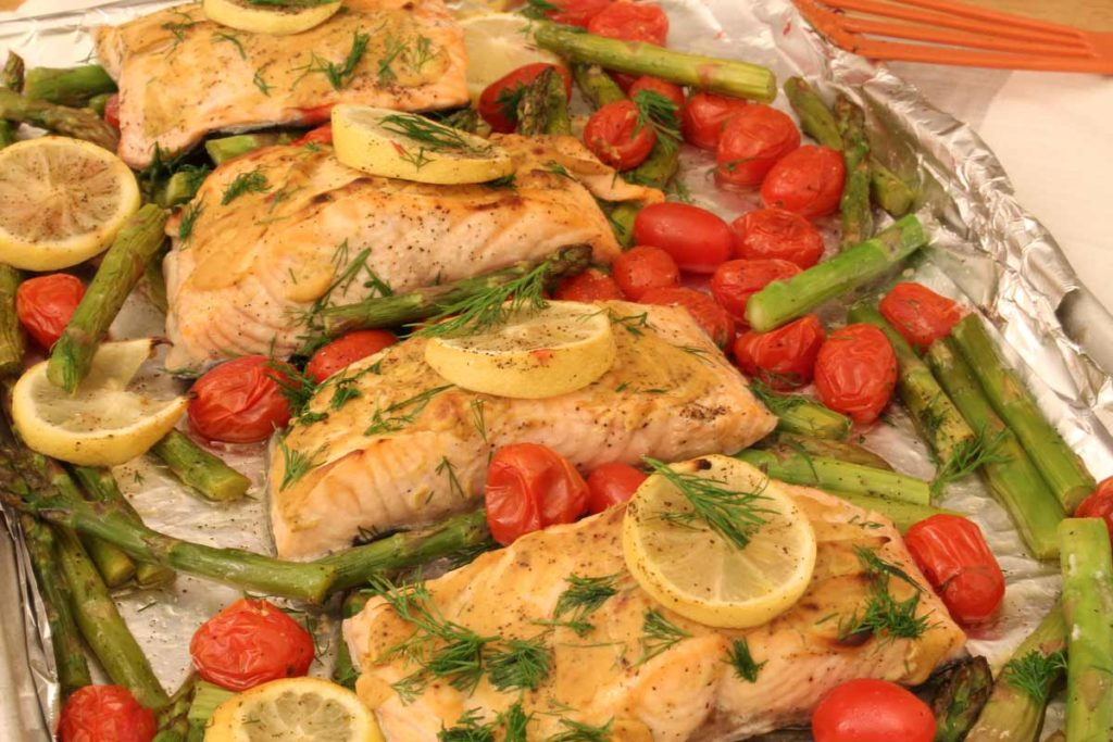 One Sheet Pan Dijon Salmon with Asparagus Recipe. It is so easy. All you have to do is put it on a sheet pan and bake. Perfect busy day dinner. www.ChopHappy.com