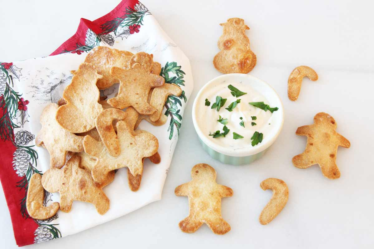 Christmas Tortilla Chips Recipe - is so christmas festive. This appetizer is is so easy to make. Grab tortillas, salt, garlic poweder, and make fun shapes. www.ChopHappy.com
