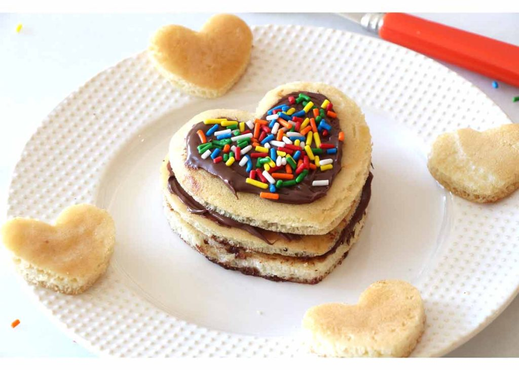 I Heart You Pancake Recipe - that is so easy you use store bought pancakes. This is awesome date food. This is fluffy, filled with Nutella , and lots of smiles every bite. www.ChopHappy.com