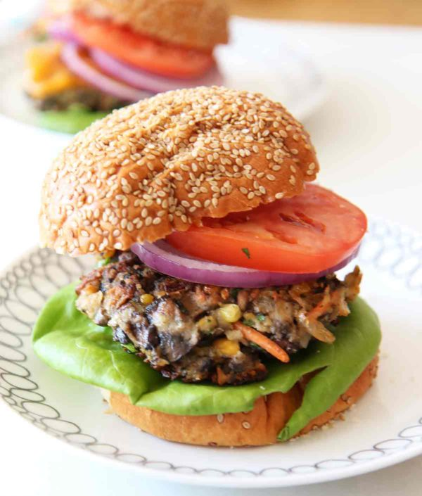 Veggie Burger Recipe. This will convert any meat eater to the veggie side. The beefy portobello, creamy crushed chick peas, and the zesty spices makes a perfect easy burger. Best part it takes 10 minutes to make. ChopHappy.com.