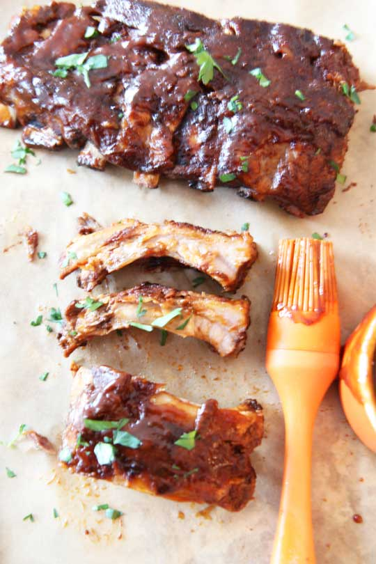 Slow Cooker Smokey BBQ Ribs Recipe. This is so easy and once the slow cooker timer goes off its ready to eat. ChopHappy.com