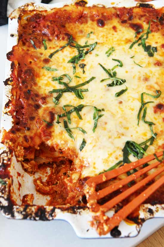 The Best Meat Lasagna Recipe - that will be your favorite Sunday night dinner recipe. It involves sweet and spicy sausage, pepperoni, and lots of cheese. This is perfect for leftovers for lunch the next day too. Happy cooking. www.ChopHappy.com