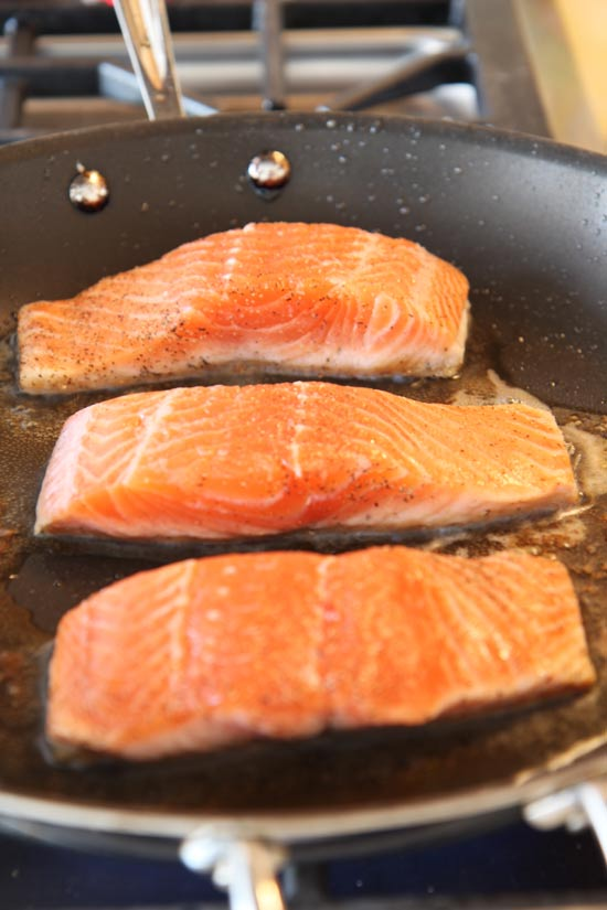 7 Minute Pan Seared Salmon Recipe that is the perfect weeknight #dinner. Every bite is crispy, flakey, and juicy yum. Happy Cooking. www.ChopHappy.com
