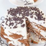 Cannoli Ice Box Cake Recipe. This is the easiest no bake dessert. Whip cream add ricotta, and warm spices. Layer cream and cookies. Then eat this indulgent cake. www.ChopHappy.com #cookies #iceboxcake #cannoli