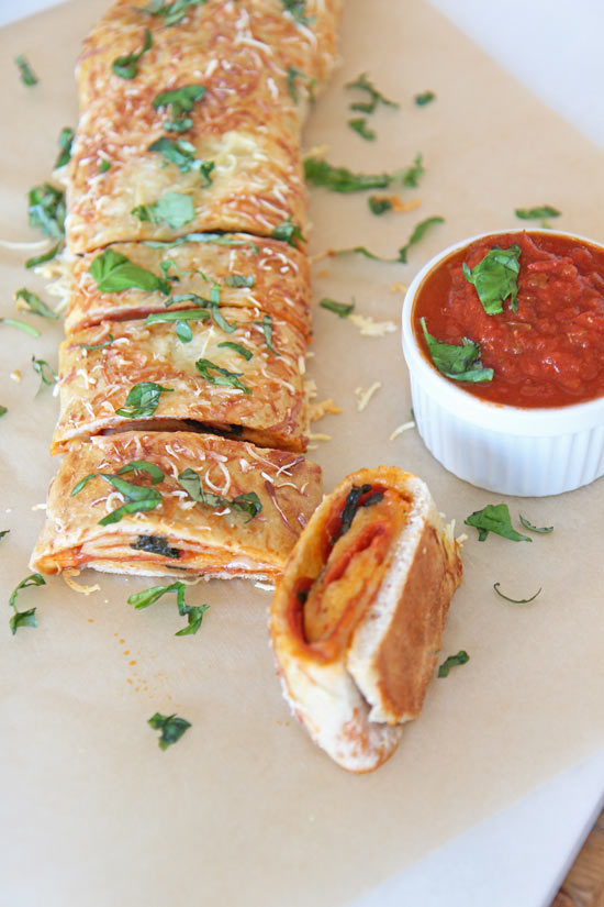 Pepperoni Pizza Stromboli Recipe. This is an easy quick dinner recipe that is a pizza all rolled up. Happy Cooking! www.ChopHappy.com #pizza #simplerecipe