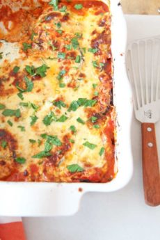 Best Baked Eggplant Parmesan Lasagna Recipe. We save time by roasting the eggplant for 10 minutes instead of breading and frying. This is a perfect weeknight dinner idea with lots of chess leftovers. Happy Cooking! www.ChopHappy.com #eggplantparmesan #dinneridea