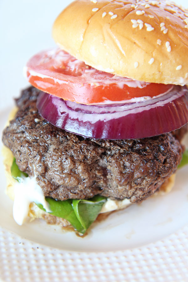 Brown Butter Burgers Recipe. Super easy 10 minute and 10 dollar recipe. All you need is butter, ground beef, salt and pepper. This is a burger party dream. Happy Cooking! www.ChopHappy.com #burgerrecipe #bestburger #butter