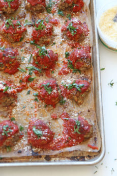 Sheet Pan Cheesy Meatball Recipe. Grab ground beef, ricotta (secret ingredient), parsley, basil, oregano, eggs, breadcrumbs, and marinara. This is an easy no mess weeknight recipe. Happy Cooking! www.ChopHappy.com #sheetpanrecipe #meatballs