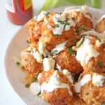 Slow Cooker Buffalo Chicken Meatballs Recipe. Grab chicken, ricotta, celery, eggs, bread crumbs, blue cheese, parsley, and ranch dressing. This is an easy dinner idea for when it is a busy weeknight! Happy cooking! #slowcookerrecipe #chickenmeatballs
