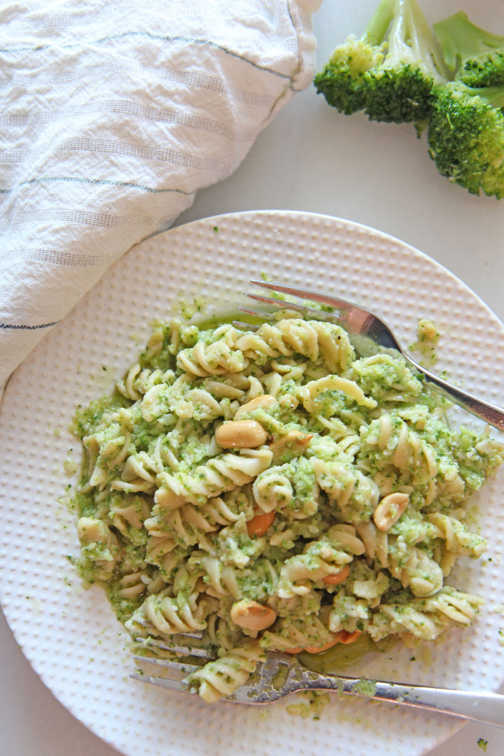 Broccoli Pesto Pasta Recipe. Grab broccoli, arugula, Parmesan, peanuts, and extra virgin olive oil. The secret ingredient is red wine vinegar to brighten it up. This is a 10 minute dinner recipe. Happy Cooking! www.ChopHappy.com #broccoli #pastarecipe
