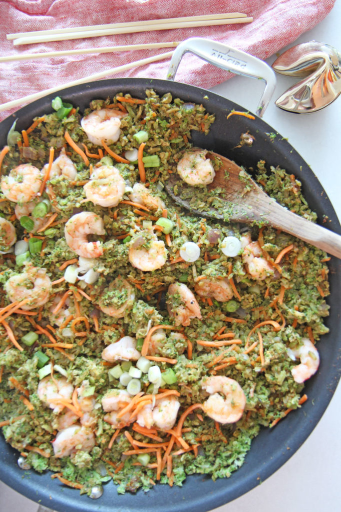 Shrimp and Broccoli Fried Rice. Fast dinner idea because use broccoli rice. Grab broccoli, garlic, ginger, onions, and shrimp. For the sauce its a combo of hoisin sauce, soy sauce, and rice wine vinegar. This is faster then take out and super fun Weeknight dinner. Happy Cooking! www.ChopHappy.com #friedrice #lowcarbrecipe