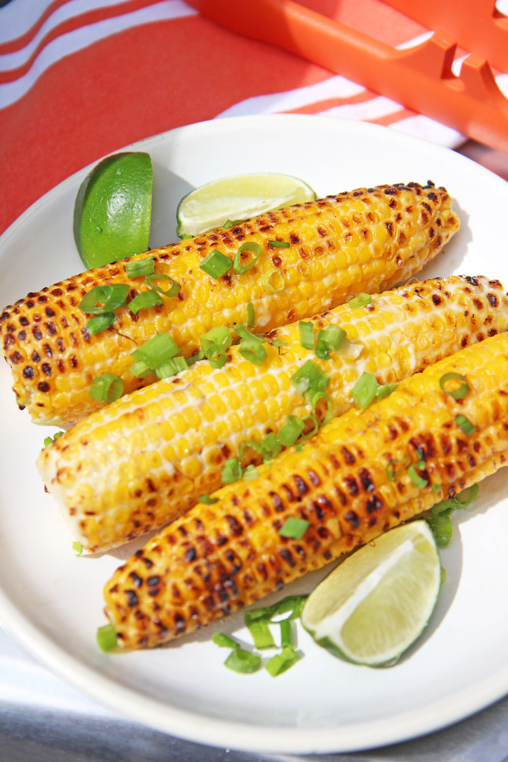 Grilled Cambodian Street Corn Recipe. This is super easy 15 minute grilling side. You make a simple sauce from coconut milk, fish sauce, scallions and sugar. Then you grill and dip till chared on the outside and sweet and juicy on the inside. Happy corn making! www.ChopHappy.com #cornrecipe #grilledcorn