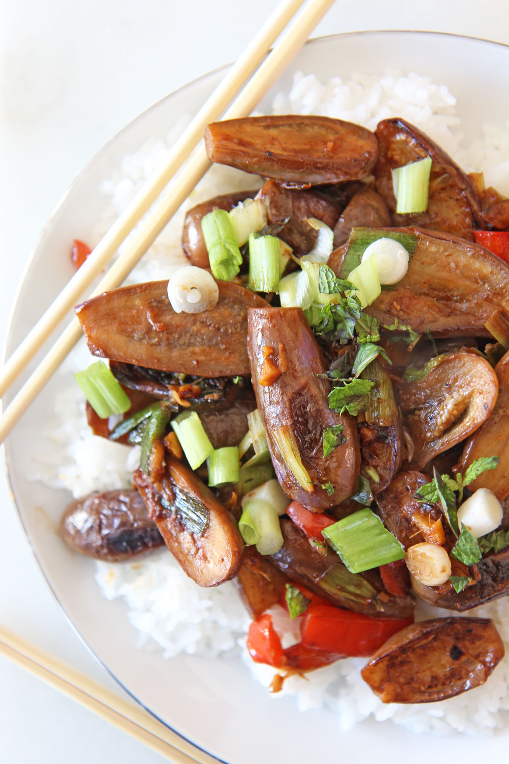 Quick Stir Fry Garlic Eggplant Recipe. Grab ginger garlic, hosin sauce, soy sauce, and eggplant. This is a quick 15 minute dinner. My favorite Sunday dinner. www.ChopHappy.com #eggplant #stirfry