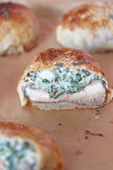 Stuffed Mushroom Wellington Recipe. Grab portabella mushrooms, spinach, cheese, and lots of herbs. This is my favorite holiday appetizer made into a puff pastry wrapped sheet pan dinner. Happy Cooking! #wellington #stuffedmushrooms