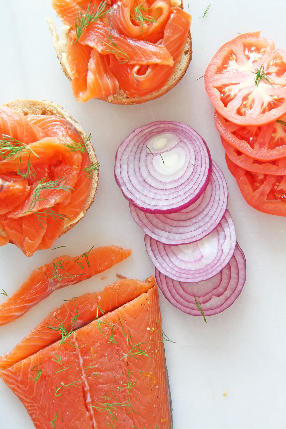 How To Make Homemade Lox (gravlax). NYC bagel classic that is as easy as salt and sugar. This salmon recipe is all done in the fridge and is a perfect brunch idea. Happy Cooking! www.ChopHappy.com #gravlax #homemadelox