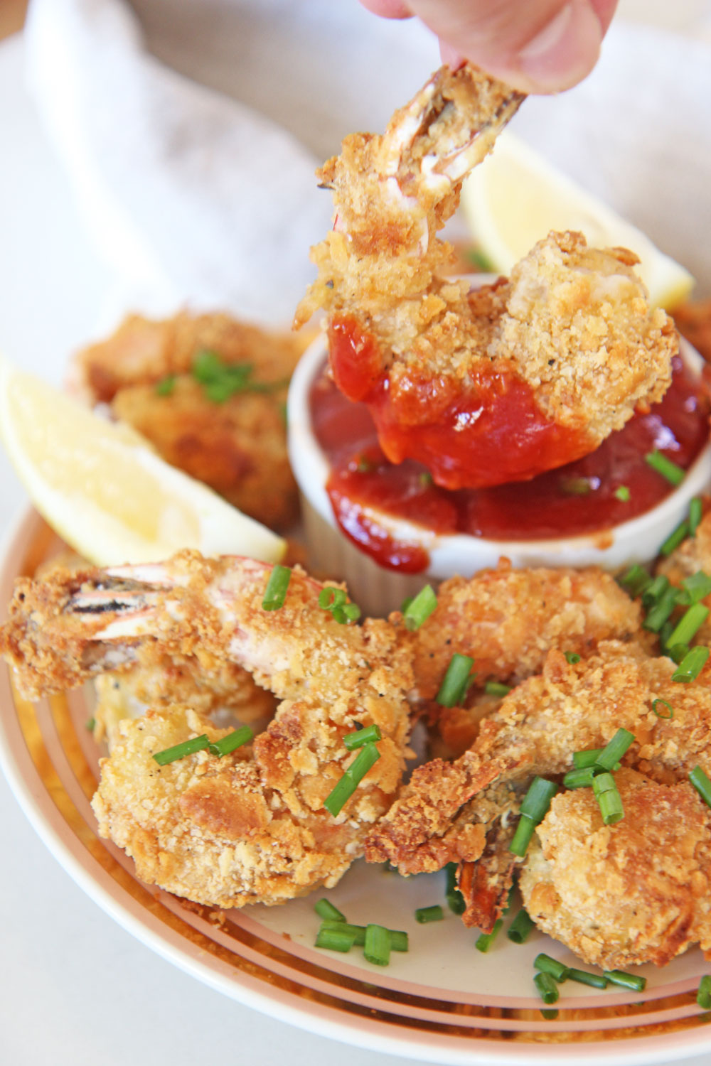 The Best Oven Fried Shrimp Recipe. Easy healthy version of fried shrimp. coat with flour, egg, and Ritz crackers. Then spray with avocado oil and bakes 10 minutes. www.ChopHappy.com #friedshrimp #ovenfriedshrimp