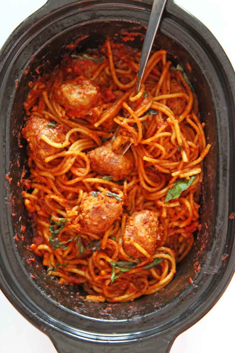 Slow Cooker Spaghetti and Meatballs (3 Ingredient Recipe). This is a super easy weeknight pasta dinner. You need spaghetti, marinara sauce, water, and sausage. Happy Cooking! www.chophappy.com #spaghettiandmeatballs #slowcookerrecipes
