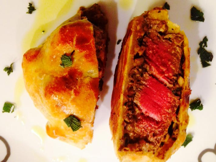 Beef Wellington Recipe - that is a flaky pocket of beefy tangy mushrooms on top of a juicy peppery steak. This is perfect for a dinner party, #weeknightrecipe, or a happy #dinner. Hope this is your new favorite #comfortfood #recipe.