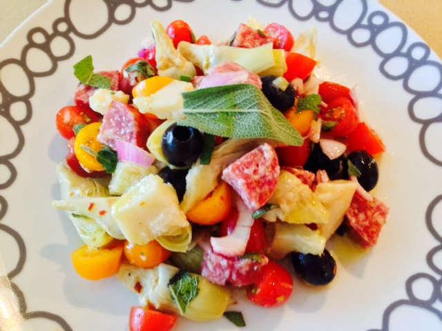 Salami Salad Recipe. Grab all your favorite Italian meats and cheese for a salty sweet salad. This si the best antipasti salad filled with salami, prosciutto, Parmesan, olives, basil, tomatoes, and vinaigrette. Happy Cooking! www.ChopHappy.com #Italiansalad #salami