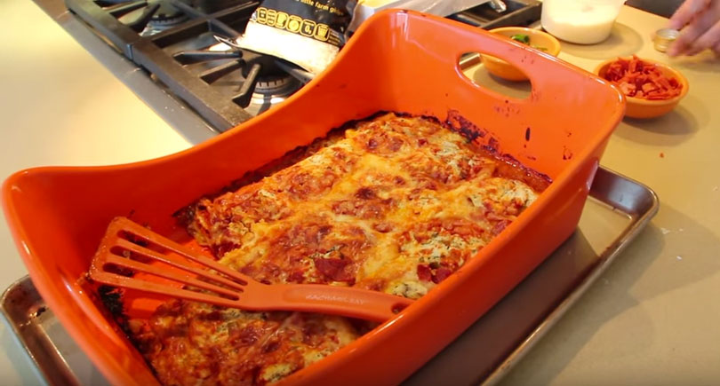 Magical Ravioli Lasagna Recipe - is easy comfort food fun. Grab raviolis, tomato sauce, cheese, and lots of Parmesan cheese. www.ChopHappy.com