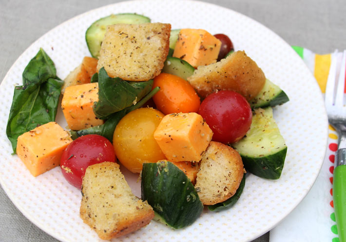 Garlic Bread Salad Recipe that is crunchy, sweet, and filled with Italian seasoning. Grab bread butter and garlic and make croutons. Then add tomato, basil, and all kinds of fresh veggies. This is a salas for weeknight fun. Happy cooking! www.ChopHappy.com #garlicbread #salad