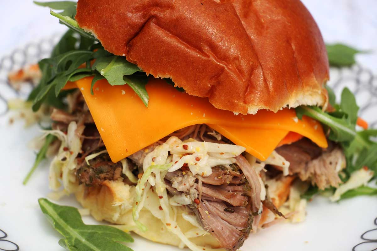 Slow Cooker Pulled Pork Recipe. This is so easy and requires so little work. Just drop the #pork in the slow cooker with lots of herbs and spices. Come home to an amazing dinner. #slowcooker #pork #pulledpork #simplerecipes