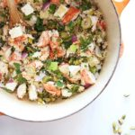 Lobster Couscous Recipe ( 10 minute meal)- a little lobster and alot of veggies makes this bright lemony dish smile every bite. The key is to go high-low. A small amount of lobster mixed with fresh mint, salty feta, and garlicky couscous. l www.ChopHappy.com
