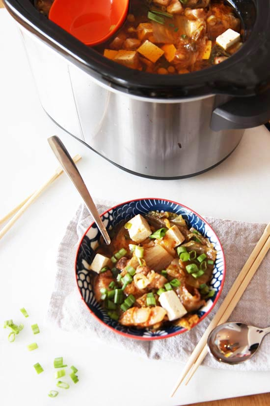 Slow Cooker Kimchi Soup Recipe- is a warm bowl of sweet and spicy comfort food hug. Just drop ingredients in slow cooker and come home to warm dinner. www.ChopHappy.com
