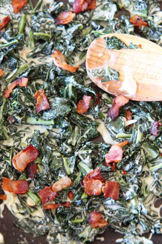 Bacon Coconut Creamed Kale Recipe - that is creamy decadent comfort food you will crave. This recipe is so easy and is a one pot side dish. Ingredients include, bacon, coconut milk, kale, garlic, red pepper flakes, and apple cider vinegar. Happy comfort food cooking! www.ChopHappy.com