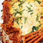 The Best Meat Lasagna Recipe - that will be your favorite make ahead party food recipe. It involves sweet and spicy sausage, pepperoni, and lots of cheese. This is perfect for leftovers for lunch the next day too. Happy cooking. www.ChopHappy.com