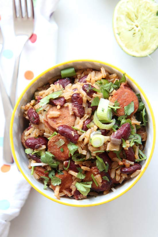 One Pot Rice and Beans Recipe- #Dinner could not get any easier and faster then fluffy buttery #rice and #beans. Everything cooks in one glorious pot. This means less clean up and more time to watch your favorite shows on TV. www.ChopHappy.com