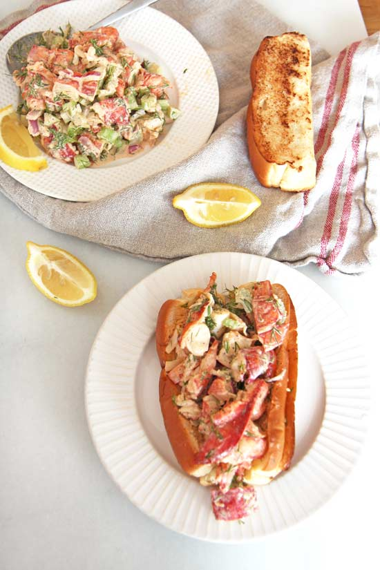 Hamptons Lobster Roll Recipe - that is sweet, tangy, and smokey yum. The pillowy crust hold easy 15 minute lobster salad. One bite and it is summer anytime. www.ChopHappy.com