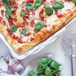 Sheet Pan Stuffed Crust Pizza (cheesy happy dinner smiles) Recipe. Grab a slice of #NYCpizza at home. This is easy quick weeknight recipe that your family will smile for. Happy #Pizza cooking! www.ChopHappy.com