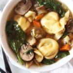 Simple Slow Cooker Tortellini Soup Recipe. The slow cooker is your personal chef. Drop chicken broth, veggies, and pasta and come home to warm easy dinner. www.ChopHappy.com #soup #slowcooker
