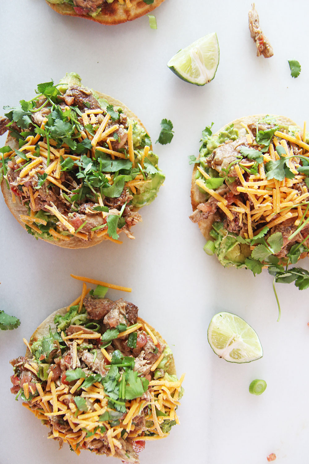 15 Minute Salsa Chicken Tostada Recipe. Grab your corn tortilla, rotisserie chicken, salsa, avocado, and cheese. This is baked in the oven and fast weeknight smiles. Happy Cooking! www.ChopHappy.com #chickenrecipe #tostada