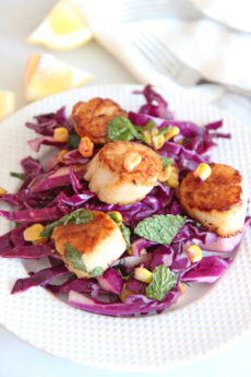 Scallops and Quick Cabbage Slaw Recipe. Grab scallops, red cabbage, shallots, apple cider vinegar, salt, pepper, mint, and enjoy! Easy summer recipe for busy weeknights! #scalloprecipe #slawrecipe