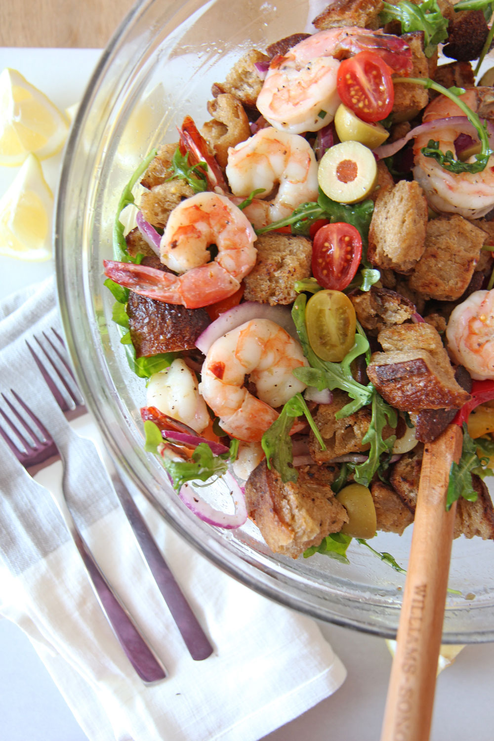 Shrimp and Garlic Bread Panzanella Salad. Grab day old sourdough bread, butter, juicy sheet pan shrimp, sweet tomatoes, and peppery arugula. This is the perfect salad for a crowd or healthy dinner. Happy Coking! www.ChopHappy.com #PanzanellaSalad #saladrecipe