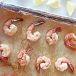 How To Make 8 Minute Sheet Pan Shrimp Recipe. Grab shrimp, garlic, extra virgin olive oil, salt and pepper. This is perfect for salad recipes, shrimp cocktails, and shrimp with pasta. Happy Cooking! www.ChopHappy.com #Howto cookshrimp #sheetpanshrimp