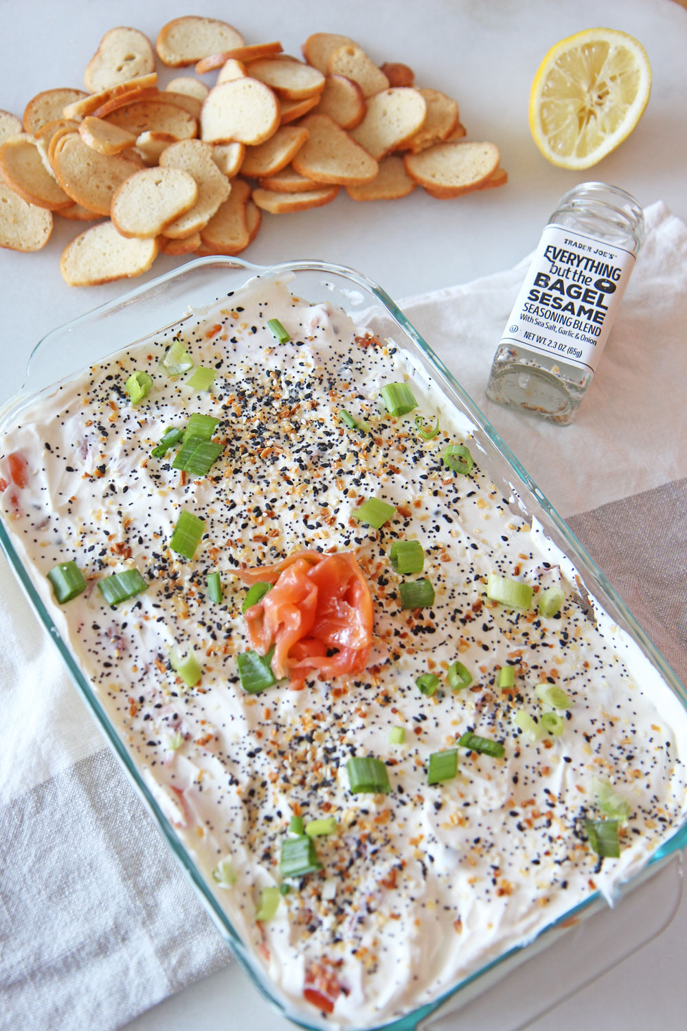 7 Layer Everything Bagel Dip Recipe. Perfect appetizer that tastes like a bagel and lox. Quick and easy starter that you can make a day in advance. Also a great host gift for the holidays. Happy Cooking! www.ChopHappy.com #everythingseasoning #7layerdip