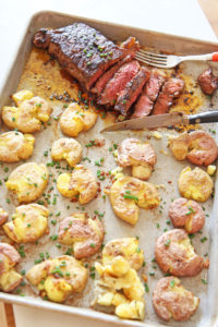 Sheet Pan Steak and Potatoes Recipe. Grab a NY Strip steak, chili seasoning, and lots of Yukon gold potatoes boiled in chicken broth. Easy dinner in less the 30 minutes. Happy weeknight cooking. www.ChopHappy.com #steakdinner #sheetpandinner