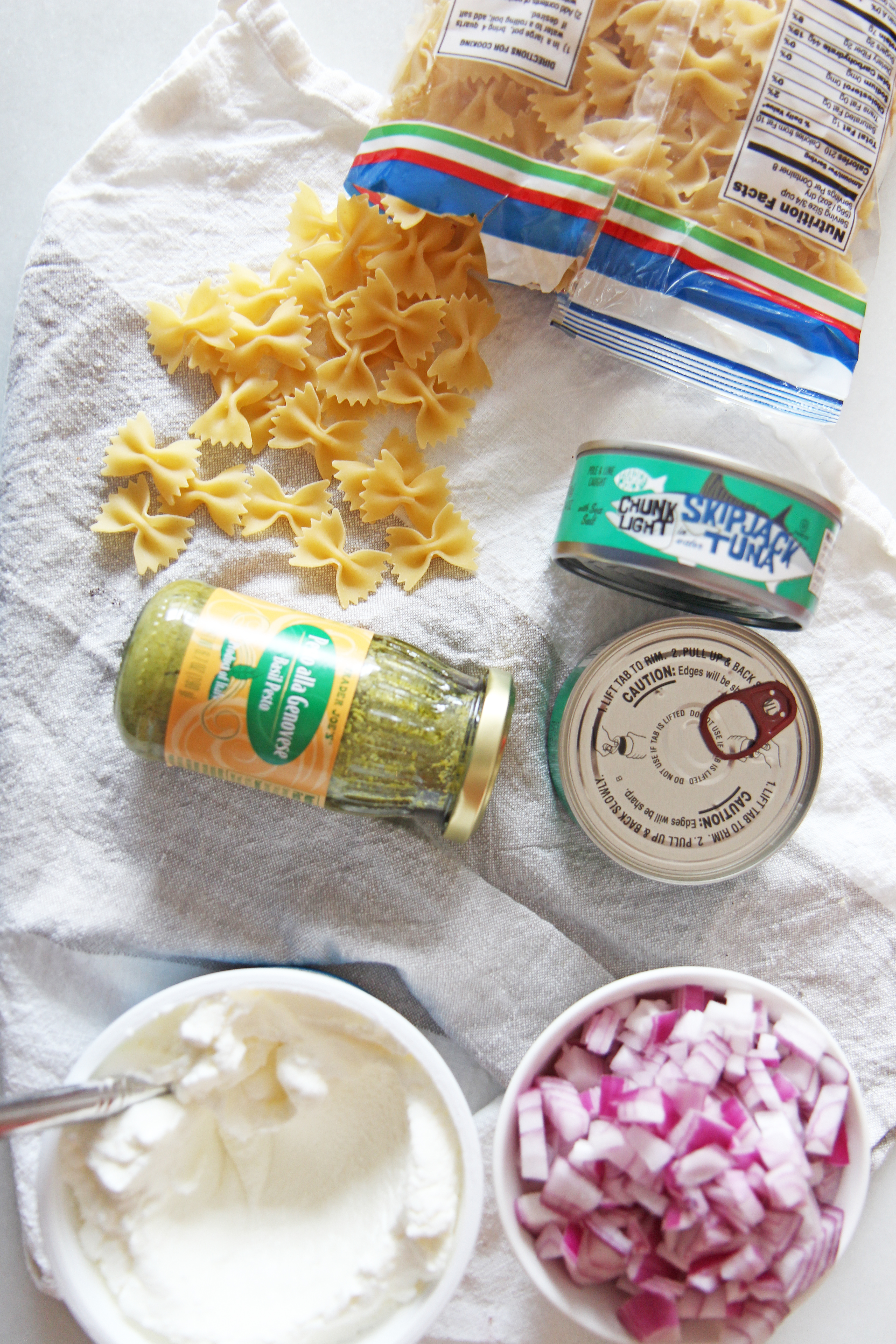 Pesto Tuna Pasta Salad (5 Ingredient Panty Recipe). With only 5 ingredients from your pantry and fridge you can have dinner in 20 minutes. Canned tuna, onions, Greek Yogurt, pasta, and pesto are the ingredients for this recipe. Happy Cooking! #pantryingredients #cannedtuna