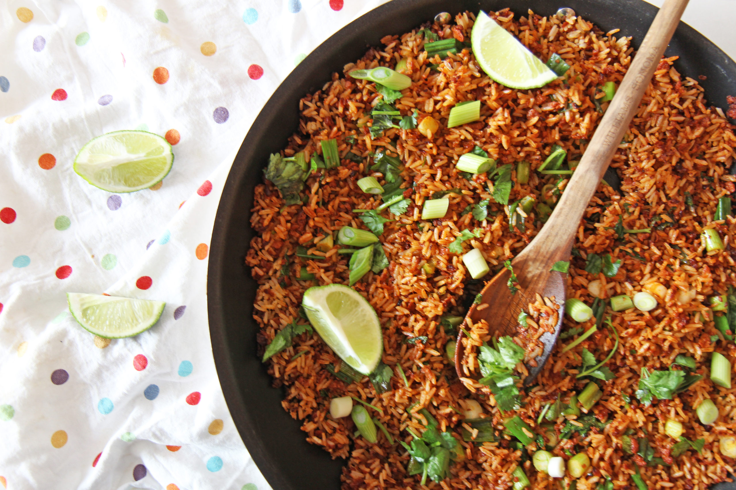 5 Ingredient Taco Fried Rice. Easy dinner for busy families. Rice, chorizo, scallions, cilantro, and lime. Also amazing leftovers. Happy Cooking! www.ChopHappy.com #friedrice #taco