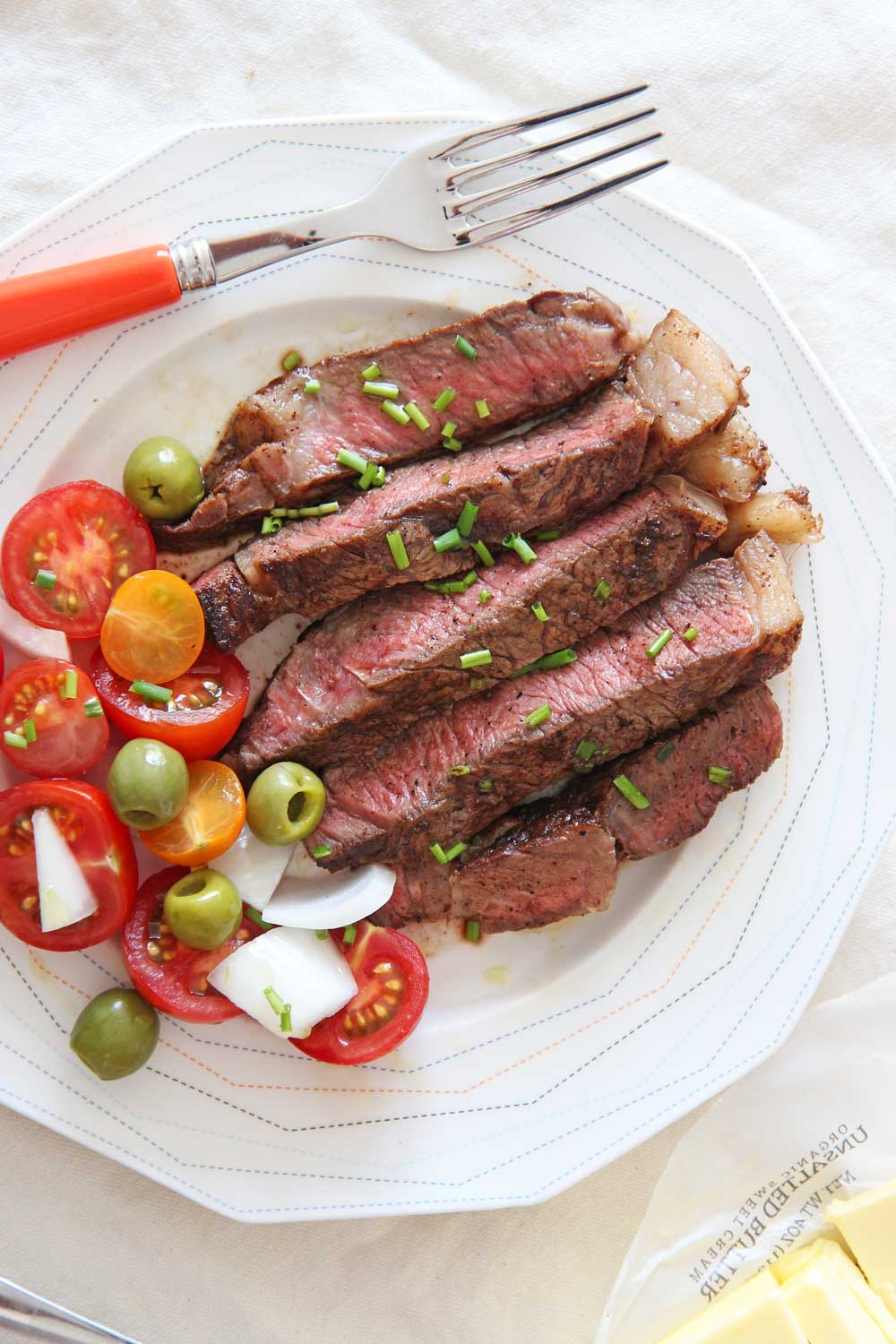 How to Reverse Sear a Steak. Its the easiest way to cook a steak. You can use a ribeye, NY strip, or any steak. You just need a sheet pan with a wire rack, cast iron pan, and butter. Happy steak making! www.ChopHappy.com #howtoreversesearasteak #reversesearedsteak