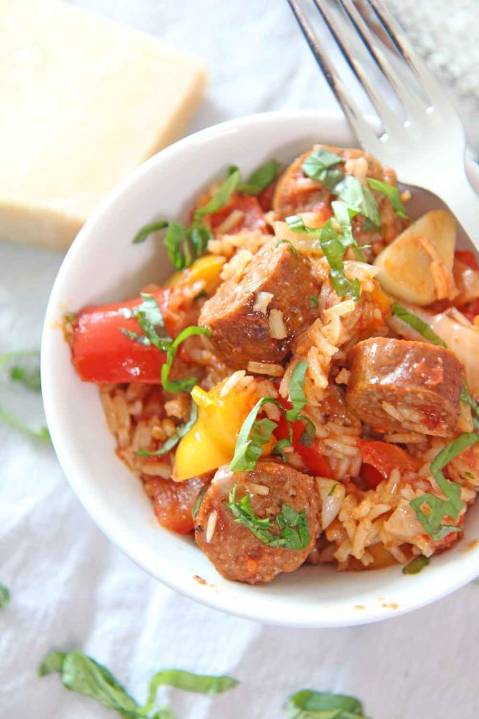 How to Make Sausage and Pepper Rice Recipe. This is an easy one pot dinner idea that takes the sausage and pepper sandwich and makes it a rice recipe! Happy Cooking! www.ChopHappy.com #ricerecipe #sausageandpeppers