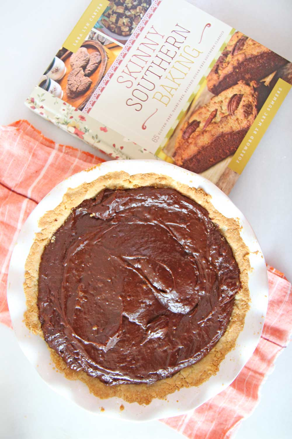 Death By Chocolate Pie (w/ Gluten Free Pie Crust) by Lara Lyn Carter. This is the best gluten free pie I have ever made. Its the easiest pie, all chocolate, and freezes easily for leftovers. Happy Gluten Baking!  www.ChopHapoy.com #gluenfreebaking #glutenfreepie