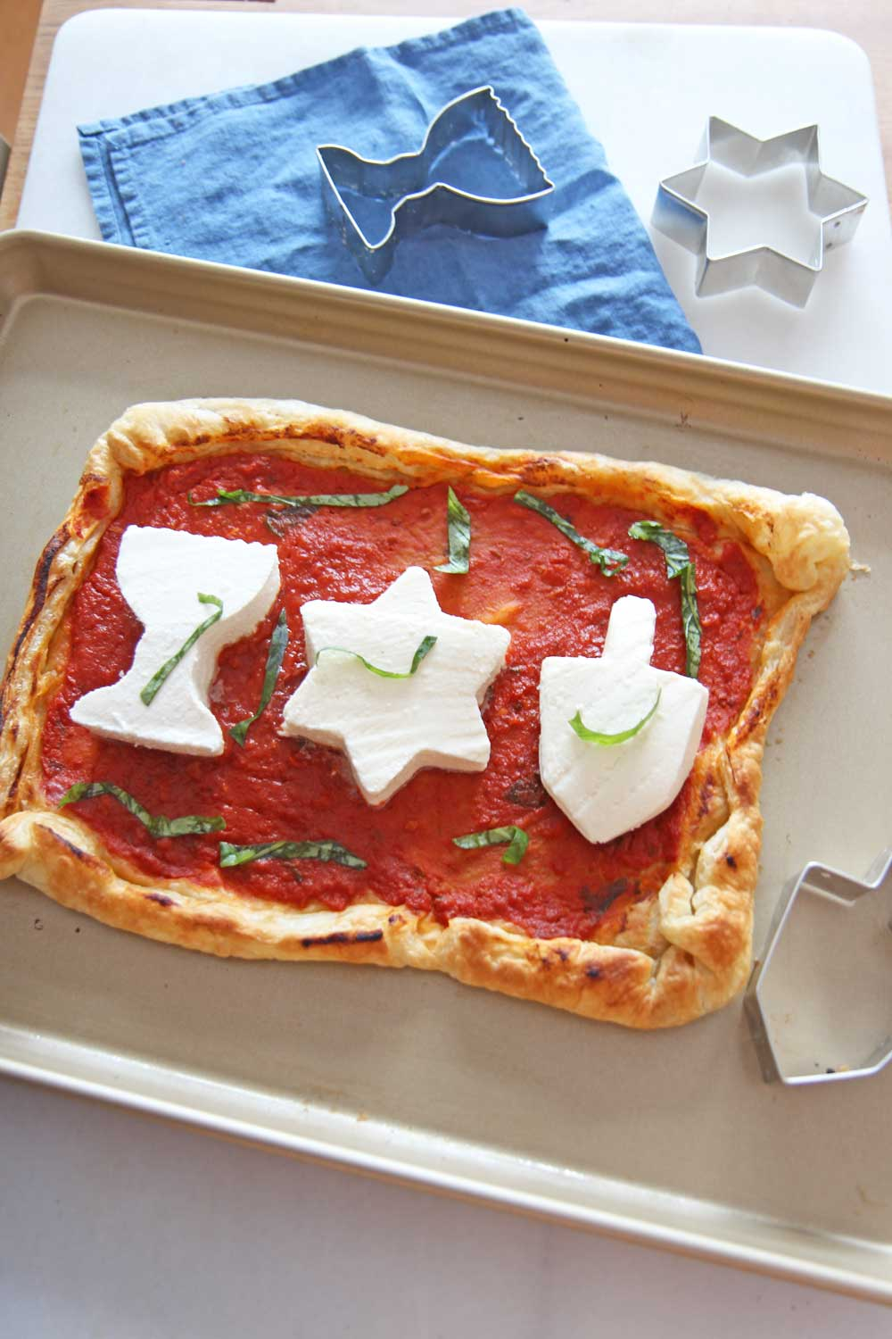 Hanukah Puff Pastry Pizza. Butter puff pastry with garlicky marinara, and mozzarella makes a festive holiday pizza! www.ChopHappy.com #HolidayRecipe #Hanukahrecipe